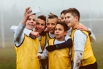 Group of children taking a selfie in their sport gear